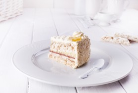 Nut meringue cake witch biscuit and butter cream